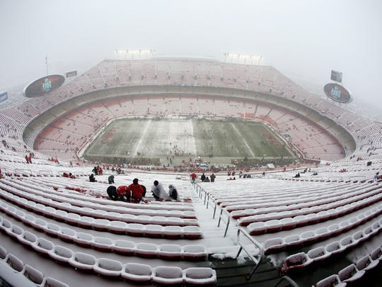 Fans arrive at a snow covered Arrowhead Stadium before an NFL divisional football playoff game between the Kansas City Chiefs and the Indianapolis Colts, in Kansas City, Mo., Saturday, Jan. 12, 2019. (AP Photo/Charlie Riedel)