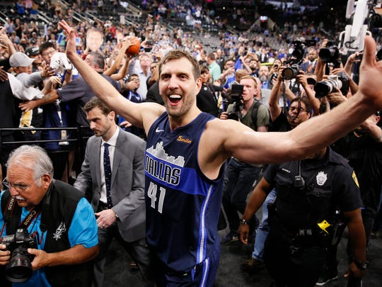 Apr 10, 2019; San Antonio, TX, USA; Dallas Mavericks power forward Dirk Nowitzki (41) high fives the fans while leaving the court after the game against the San Antonio Spurs at AT&T Center. Mandatory Credit: Soobum Im-USA TODAY Sports ORG XMIT: USATSI-385875 ORIG FILE ID:  20190410_ads_ai1_166.JPG