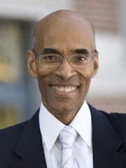 Mark J.T. Smith, dean of the university's graduate school, is part of the Diversity and Inclusion Team, which Dutta created as part of his reorganization of the Division of Diversity and Inclusion.