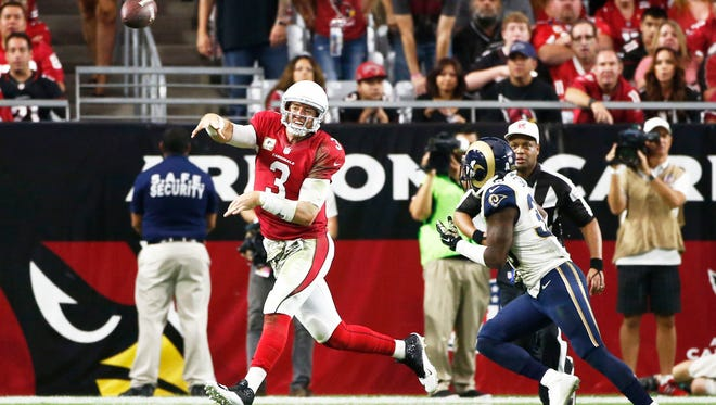 Cardinals quarterback Carson Palmer throws a pass against the St. Louis Rams on Sunday, Nov. 9, 2014 at University of Phoenix Stadium in Glendale.