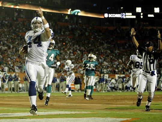Dallas Clark reacts after scoring a touchdown on the