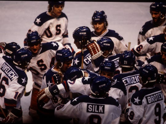 The USA Team celebrates their 4-3 victory over Russia