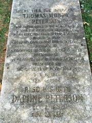 The gravestone of Thomas Mundy Peterson, the first