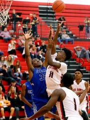 Stewarts Creek's Donnie Jackson (11) goes up for a shot as Wilson Central's Kene Aruh (32) defends him on Tuesday, Nov. 28, 2017, at Stewarts Creek.
