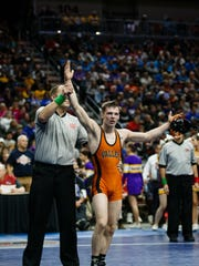 ValleyÕs Nick Oldham celebrates after defeating Caleb Rathjen of Ankeny during their class 3A 113 pound championship match at Wells Fargo Arena on Saturday, Feb. 17, 2018, in Des Moines.