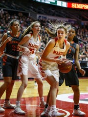 Marion's Chloe Rice (4) looks for a shot during the