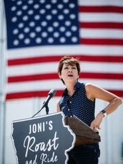 Iowa Governor Kim Reynolds speaks during the fourth
