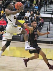 Alamogordo's Danilan Smith glides toward the basket