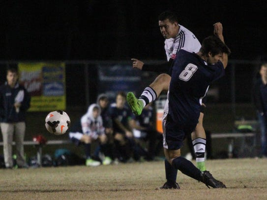 "Godby's Carlos ""Tito"" Sanchez takes a shot during a"