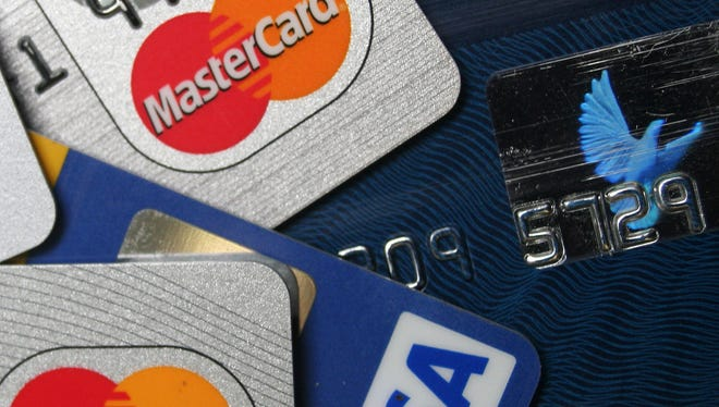 FILE - This file photo taken Nov. 18, 2009, a pile of MasterCard and VISA credit cards are displayed in Frankfurt, Germany.