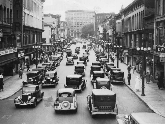Cars stream down Court Street in the 1930s.
