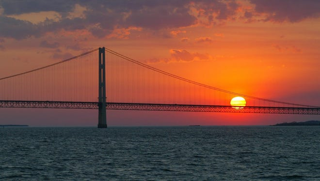 The sun sets over the Mackinac Bridge and the Mackinac Straits near St. Ignace, Mich., in this May 31, 2002, file photo.