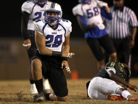 Godby's Kyler Laing celebrates a tackle in the backfield