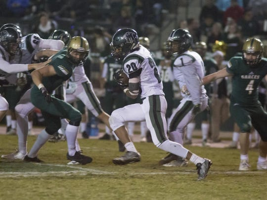 El Diamante runner DeVonte Freeman finds running room against the Garces defense during the first half of Friday's playoff game at Garces High.