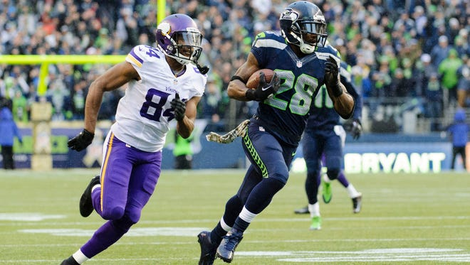 Seattle Seahawks cornerback Walter Thurmond (28) runs the ball in for a touchdown after intercepting a pass by Minnesota Vikings quarterback Christian Ponder (7) (not pictured) during the second half at CenturyLink Field in Seattle on Nov. 17, 2013.