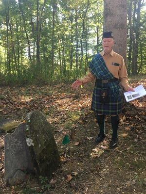Reverdy Wright, of Christiansburg, says a few words next to the grave of his ancestor, Capt. John Young, who was a Revolutionary War soldier, at an event to honor him at the Glebe Burying Ground in Swoope, Va., on Saturday, Sept. 30, 2017.