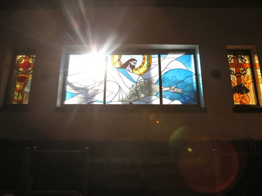 A stained glass image of Jesus Christ at the Blessed Sacrament Catholic Church on