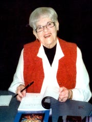 Poet Mary Hughes at a book signing.