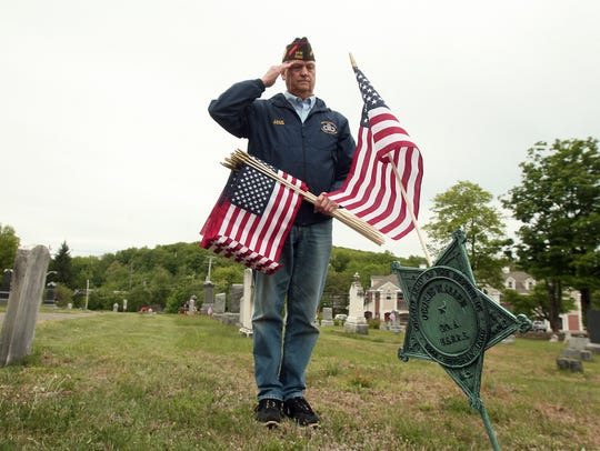 Quartermaster Jack Sassaman salutes as members of Randolph