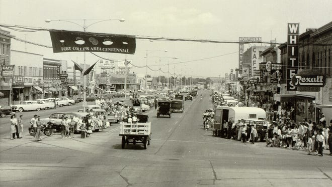 """The scene on College Avenue during Fort Collins' centennial parade in 1964. It was the same year the Fort Collins Area Chamber of Commerce first used """"The Choice City"""" in its local ads."""