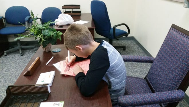 Jackson Heller works on his opening speech in his office at BizTown.