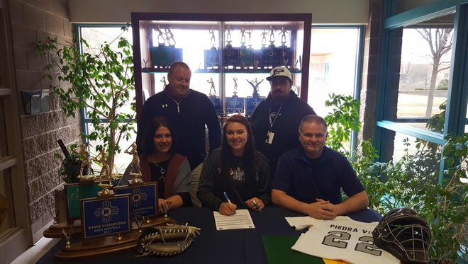 Piedra Vista senior Haley Parson, center, signs a national letter of intent to play softball at Yavapai College on Tuesday at Piedra Vista in Farmington.