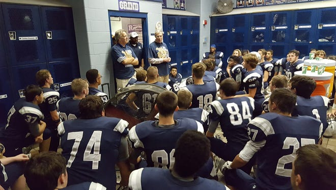 "Tom Buck and Bob Nelson, who played linebacker and quarterback on Reitz's 1971 mythical state championship team, addressed a recent Panther team prior to a game with Castle. The '71 team was Reitz's representative in the C&P ""Eight Elite Schools, Eight Elite Teams"" contest."