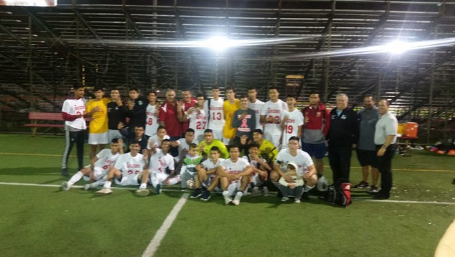 North Bergen boys soccer coach John Belluardo, sixth from left in the back recently picked up his 400th win.