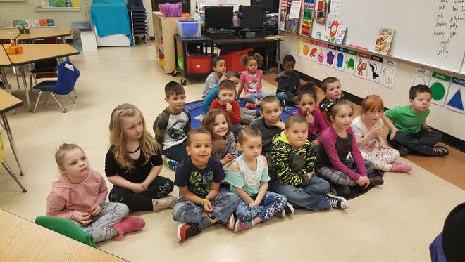 Domtar employees read to students at Kimball Elementary as part of a book donation innitative on March 28, 2018