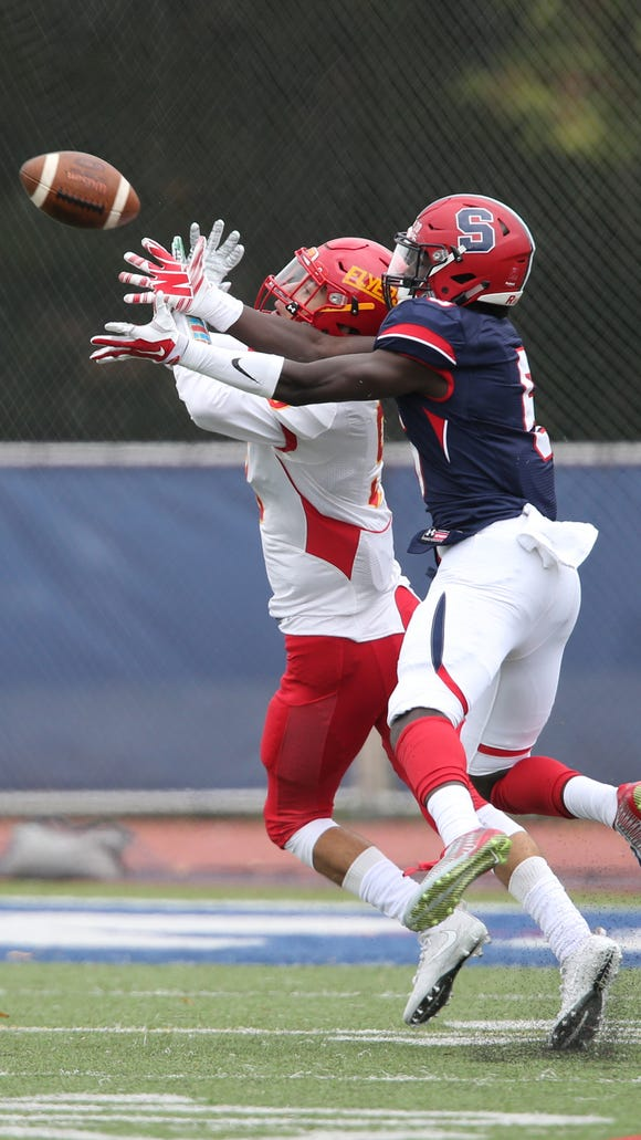 Stepinac's Trill Williams (6) breaks up a pass during their 34-7 win over Chaminade in CHSFL 'AAA' football action at Archbishop Stepinac High School in White Plains on Saturday, September 30, 2017.
