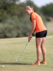 Robert Lee's Kelby Clawson tries to sink a putt during