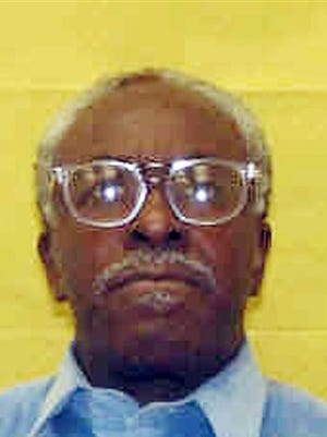 This photo provided by the Ohio Department of Rehabilitation and Corrections shows Wiley Bridgeman. The Cuyahoga County prosecutor's office has filed a motion dismissing aggravated murder cases against three men falsely accused of killing a businessman outside a corner store in Cleveland in 1975. Fifty-seven-year-old Ricky Jackson, 60-year-old Bridgeman and his brother, 57-year-old Ronnie Bridgeman, were sentenced to death during separate trials in 1975 for the slaying of Herman Franks. Their convictions were based solely on the testimony of a 13-year-old boy who in 2013 recanted and said he was coerced and threatened by Cleveland police detectives.