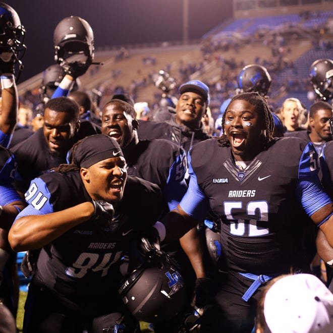 MTSU players celebrate after defeating Western Kentucky 50-47 in triple overtime Saturday, Sept. 13, 2014.