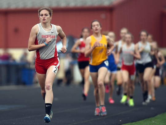Sheridan's Anna Foster runs away from the pack during the 3200 at the Muskingum Valley League Track and Field Championships on Friday at Maysville. Foster takes the state's top regional time into the 3200 for Saturday's Division II state meet at Ohio State's Jesse Owens Memorial Stadium.