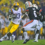 LSU Tigers running back Jeremy Hill (33) is one of many prospects playing in Saturday's SEC West showdown in Tuscaloosa, Ala.