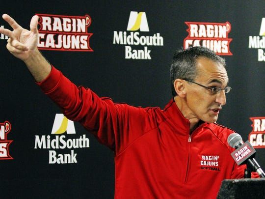 UL Softball Coach Michael Lotief talks to media Monday, May 18, 2015, during a press conference at the UL Sports Information Office in Lafayette, La.