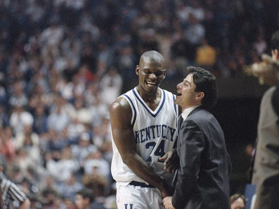 Kentucky coach Rick Pitino shares a light moment with