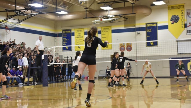Plymouth Christian senior setter Jessica Paulson (No. 6) serves the ball during Tuesday's Class D quarterfinal against Mendon at Climax-Scotts.