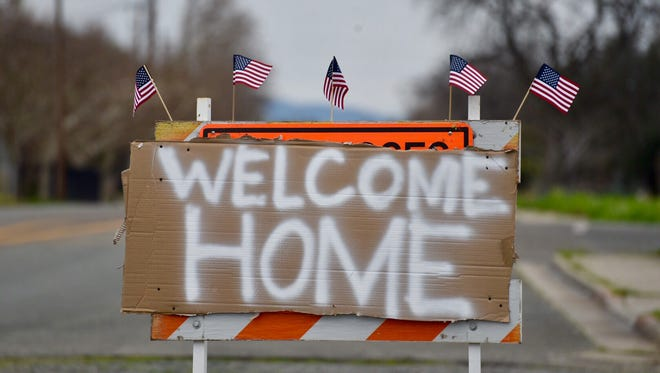 A welcome sign greets drivers entering Oroville on Thursday after an evacuation order was lifted.