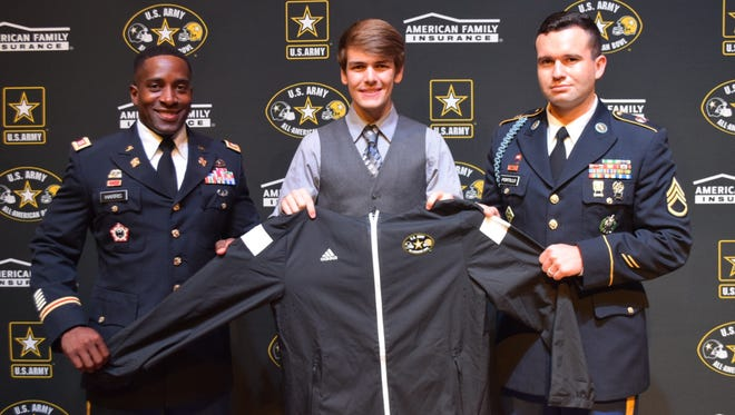 Honorary presentation of the All-American Band jacket to Riverdale student John Wilson by Captain Shallum Harris Staff Sergeant Portillo.