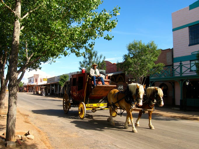 Stagecoaches and covered wagons clop through tombstone