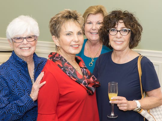 Harriet Joseph, left, Lorraine Cardarelli, Linda Mundt and Leah Benincasa enjoy the festivities Jan. 25 at Piper's Landing Yacht and Country Club.
