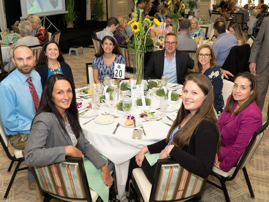 Diane Kirkland, front left, Thomas Schinske, Genevieve George, Rani Mathura, Stephen Schramm, Colleen Schramm, Julie Sacco-Lunsford, and Megan Graham at the  Hearts for Hope Luncheon Jan. 25 at Piper's Landing Yacht and Country Club.