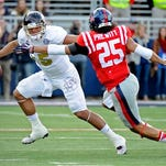 Mississippi State quarterback Dak Prescott (15) looks for room past Ole Miss defensive back Cody Prewitt (25) in their game last season.