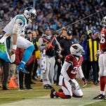 Carolina Panthers' Cam Newton celebrates a first down run during the second half the NFL football NFC Championship game against the Arizona Cardinals Sunday.