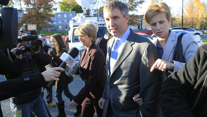 From left, Douglas Kennedy and his wife, Molly, enter the Richard Flynn Justice Court for the Village and Town on Mount Kisco for the first day of trial on Oct. 22, 2012.