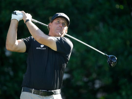 Phil Mickelson hits from the 11th tee during the second round of The Players Championship golf tournament Friday, May 8, 2015, in Ponte Vedra Beach, Fla.