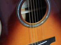 Yamaha guitar makes electric sounds acoustically