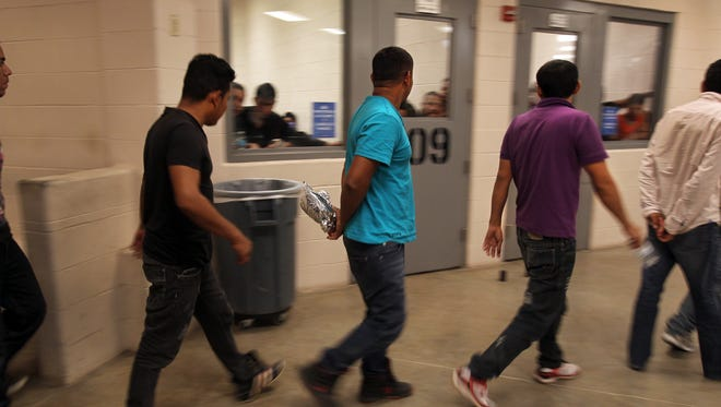 Immigrants who have been caught crossing the border illegally are housed inside the McAllen Border Patrol Station in McAllen, Texas, where they are processed on July 15.