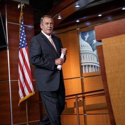 House Speaker John Boehner of Ohio arrives for a news